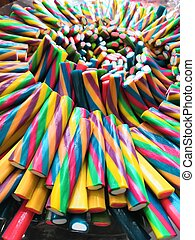 Sour jelly strips in candy shop. Colorful chewing marmalade for background