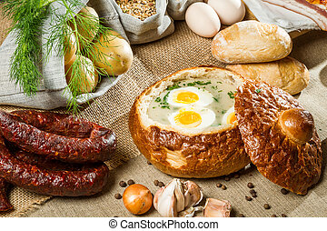 Sour soup served in bread with egg on Easter