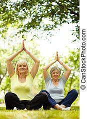Source of energy - Portrait of two aged females practicing...