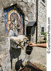 Source of holy water and an icon in a monastery on the river Moraca