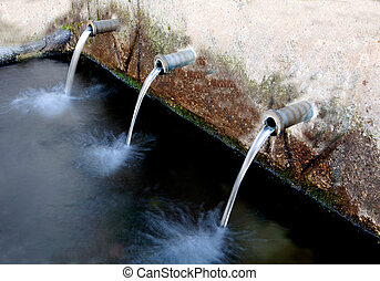 Source of three pipes with crystal clear water