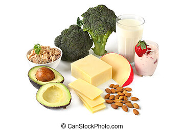 Sources of Calcium - Calcium-rich foods, on white...