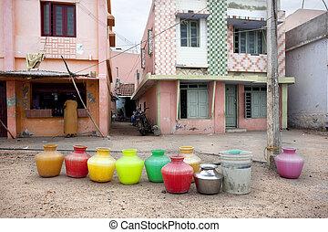 sources - Kanyakumari, India-September 9, 2012. several jugs...