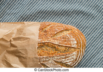 sourdough bread in paper bag