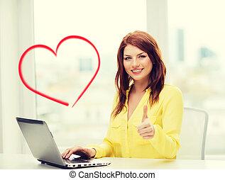 sourire, étudiant, à, ordinateur portatif, à, école