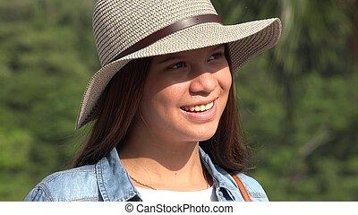 sourire, adolescente, à, chapeau