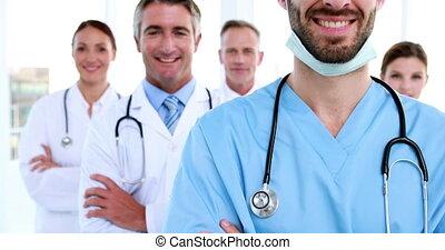 sourire, appareil photo, équipe, monde médical