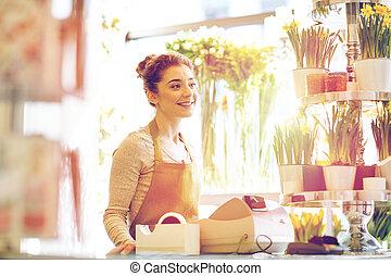 sourire, fleuriste, femme, à, magasin fleur, caisse
