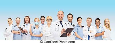 sourire, presse-papiers, groupe, médecins