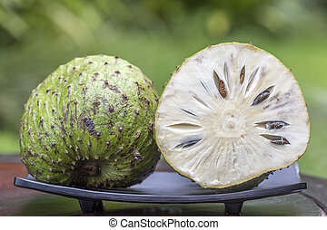 Soursop, Guanabana, Custard Apple, Annona muricata on nature...