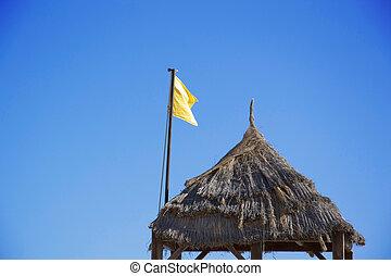 Sousse - yellow flag on the beach in Tunesia