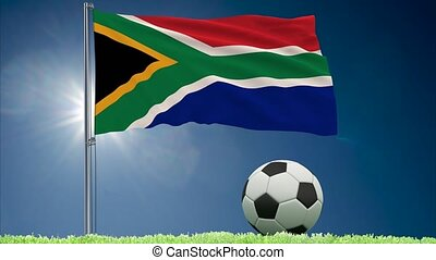 South Africa flag fluttering and football rolls - Flag of...