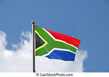 The Flag of South Africa waving in the breeze on a flagpole against a blue sky