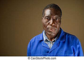 South African or American black senior worker or blue collar...