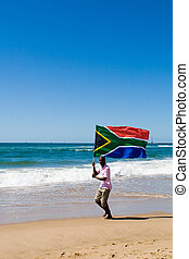 south african - a south african man running on beach with...