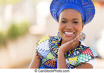 south african woman outdoors - close up portrait of cute...