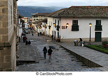 South American Street Scene - Night falls upon the city of...