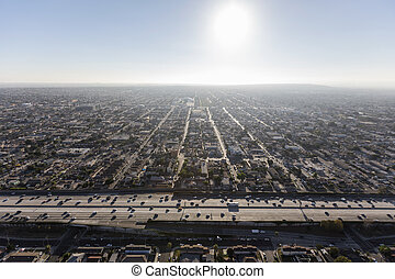 Afternoon aerial of South Central Los Angeles and the Harbor 110 freeway.