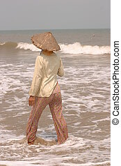 South China Sea Woman Fishing - woman standing in South ...