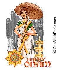 South Indian Keralite woman with umbrella celebrating Onam -...