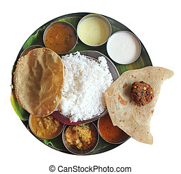 South indian plate lunch on banana leaf on white -...