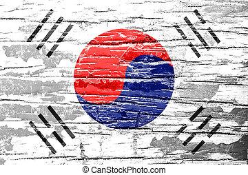 South Korea flag on grunge wood background