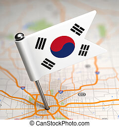 South Korea Small Flag on a Map Background.
