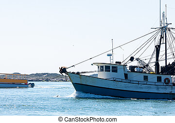 South Padre Island - Old fishing boat navigating the Brazos ...