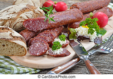 Typical South tyrolean smoked sausages (called 'Kaminwurzen') with fresh horseradish and rye flat bread