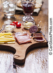 south tyrolean specialites on wood
