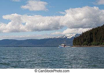Southeast Alaskan fishing trawler heading out on a summer day.