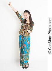 Southeast Asian girl celebrating success