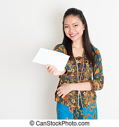 Southeast Asian girl hand holding white paper card -...