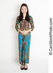 Southeast Asian girl in batik dress