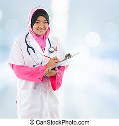 Southeast Asian Muslim medical student. Young medical doctor...