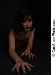 Southeast asian woman with dark tone makeup on black background, portrait photography