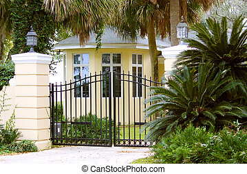 Stunning yellow mansion protected in a gated community