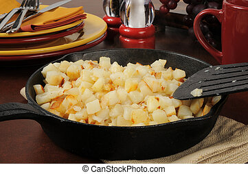 Southern style hash brown potatoes in a cast iron skillet