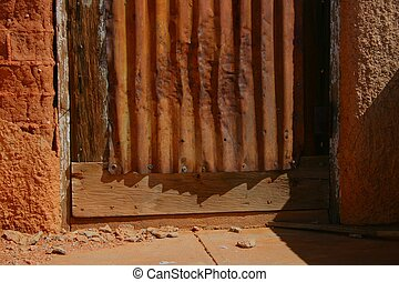 Southwest Abstract - Textures of adobe, wood, and weathered...