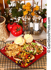 Tex Mex style chicken and yellow squash casserole with lettuce, black-eyed pea, and green bean salad.