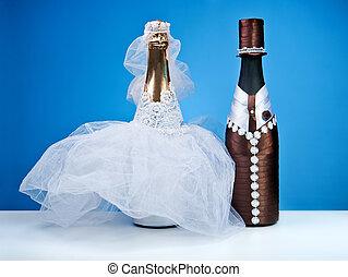 Souvenir bottles for a wedding on a blue background.