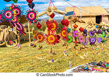 Souvenir from reed on Floating islands Titicaca lake, Peru, ...