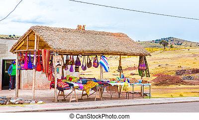 Souvenir market near towers in Sillustani, Peru,South...