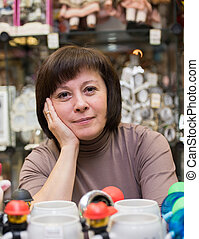 souvenir seller - middle-aged woman in the gift shop seller