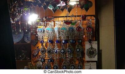 Souvenir shop. - A souvenir shop with eye bead at night in...