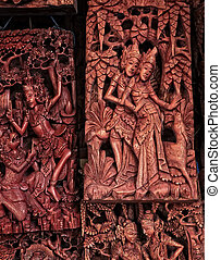 Souvenirs - Balinese wood carvings on sale at the local...