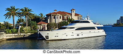GOLD COAST - OCT 14 2014:Luxury home and super yacht in Sovereign Islands. It's one of the most expensive areas in Gold Coast Queensland and Australia with some homes in excess of 20 million dollars.