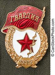 Soviet army Guard emblem on the green uniform