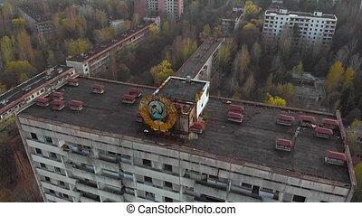 Soviet coat of arms on a building in Pripyat - Soviet coat...
