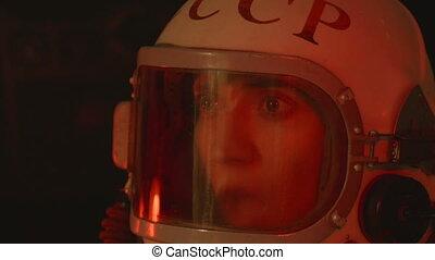 Soviet Cosmonaut in Pain - Dying cosmonaut in capsule.